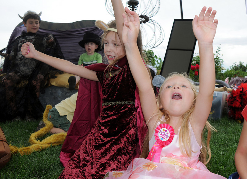 Ava Nordgren ,5, right, and her sister Gracie Nordgren, 8, cheer during a play with the Backstory Theater booth at the Broomfield Council on the Arts and Humanities Summer Sundays at the Brunner <br /> Farmhouse.<br /> <br /> July 11, 2010<br /> Staff photo/ David R. Jennings