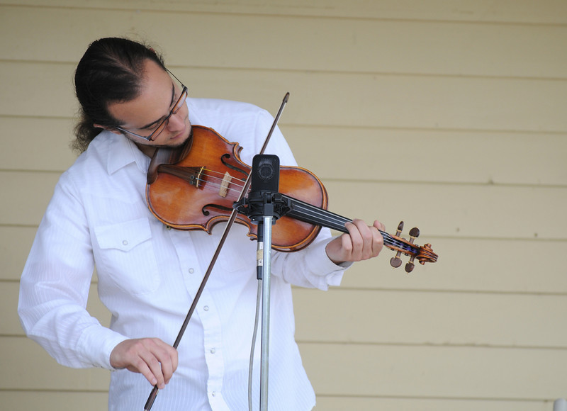 Justin Hoffenberg plays the fiddle for Martin Gilmore and Long Road Home bluegrass band during the Broomfield Council on the Arts and Humanities Summer Sundays at the Brunner <br /> Farmhouse.<br /> <br /> July 11, 2010<br /> Staff photo/ David R. Jennings
