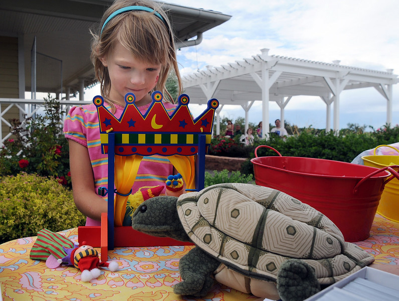 Brooke Hagen, 6, performs a finger puppet play for a turtle during the Broomfield Council on the Arts and Humanities Summer Sundays at the Brunner <br /> Farmhouse.<br /> <br /> July 11, 2010<br /> Staff photo/ David R. Jennings