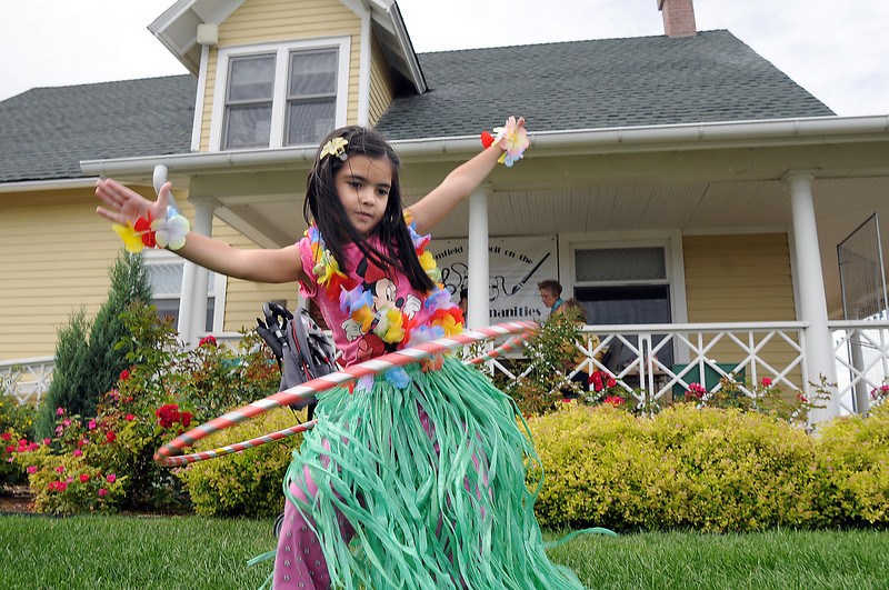 Lujane Yacoub, 5, does the hula during the Broomfield Council on the Arts and Humanities Summer Sundays at the Brunner <br /> Farmhouse.<br /> <br /> July 11, 2010<br /> Staff photo/ David R. Jennings