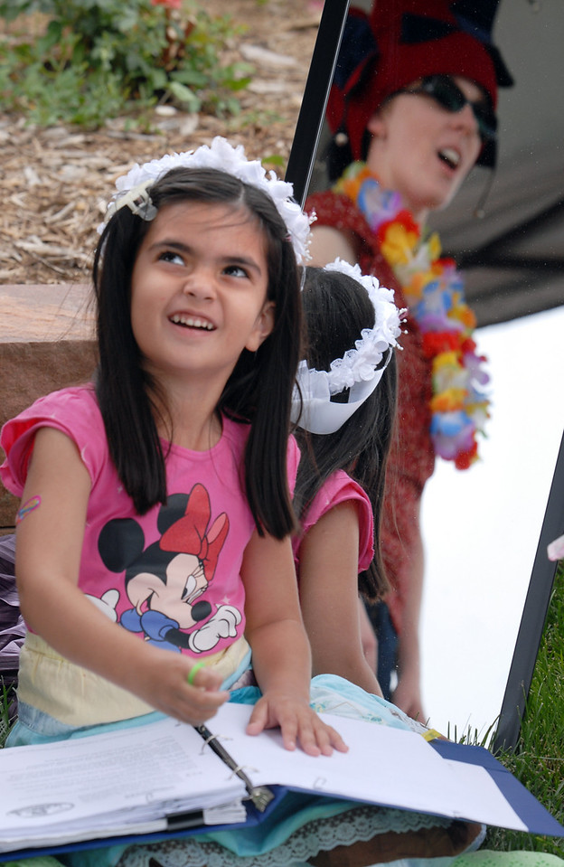 Lujane Yacoub, 5, looks at director Anna Marie Wilcox while playing the princess reading the story that becomes the play during the Broomfield Council on the Arts and Humanities Summer Sundays at the Brunner Farmhouse.<br /> <br /> July 11, 2010<br /> Staff photo/ David R. Jennings
