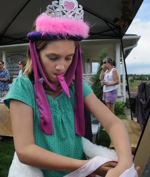 Sarah Hollis, 11, gets dressed as queen kazzoo at the Backstory Theater Academy booth during the Broomfield Council on the Arts and Humanities Summer Sundays at the Brunner <br /> Farmhouse.<br /> <br /> July 11, 2010<br /> Staff photo/ David R. Jennings