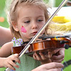 Kayla Farrell-Herrick, 2, gets a little help with playing the violin from Morag Barrett during Summer Sundays at the Brunner Farmhouse on Sunday.<br /> <br /> <br /> July 8, 2012<br /> staff photo/ David R. Jennings