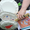 "A mother holds ""banjos"" made form paper plates and decorated by children during Summer Sundays at the Brunner Farmhouse on Sunday.<br /> <br /> July 8, 2012<br /> staff photo/ David R. Jennings"