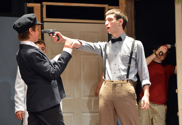 Anthony Smith, 17, right, playing Patrick O'Reilly pulls a gun on Bryan Lucchesi, 12, playing police officer Michael Kelly during rehearsal for the Summer Youth Players production of The Musical Comedy Murders of 1940 at Legacy High School.<br /> June 14, 2012 <br /> staff photo/ David R. Jennings