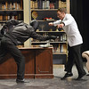 Andrew Lyle, 18, right, Eddie McCuen, avoids the knife (actually a spoon) thrust by the masked man, Jared Wold, 16, during rehearsal for the Summer Youth Players production of The Musical Comedy Murders of 1940 at Legacy High School.<br /> June 14, 2012 <br /> staff photo/ David R. Jennings
