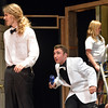 "The ""hero"" Andrew Lyle, 18, left, playing Eddie McCuen,, sneaks behind Jared Wold, 16, playing Ken De La Maize, with a bottle during rehearsal for the Summer Youth Players production of The Musical Comedy Murders of 1940 at Legacy High School. The stage crew members work on the set during rehearsal.<br /> June 14, 2012 <br /> staff photo/ David R. Jennings"