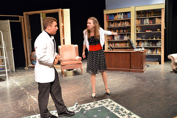 Andrew Lyle, 16, playing Eddie McCuen, left, interacts with Alexa Brown, 17, playing Nikki Crandall, during rehearsal for the Summer Youth Players production of The Musical Comedy Murders of 1940 at Legacy High School.<br /> June 14, 2012 <br /> staff photo/ David R. Jennings