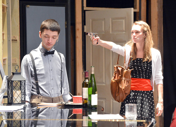 Alexa Brown, 17, right, playing Nikki Crandall , pulls a gun on Anthony Smith, 17, playing Patrick O'Reilly during rehearsal for the Summer Youth Players production of The Musical Comedy Murders of 1940 at Legacy High School.<br /> June 14, 2012 <br /> staff photo/ David R. Jennings