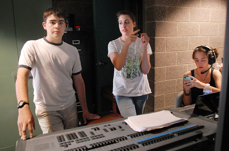 Jonathan Tibbetts, left, lighting, listens to co-director Hailey Barr as they work on the lighting with Rachel Kois, right, in the booth during the Summer Youth Players tech rehearsal of The Wizard of Oz at Broomfield High School on Saturday.<br /> June 18, 2011<br /> staff photo/David R. Jennings