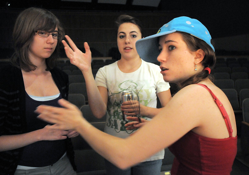 Kayle Lingo, 14, left, listens to the instructions of co-directors Hailey Barr and Maggie Admire during the Summer Youth Players tech rehearsal of The Wizard of Oz at Broomfield High School on Saturday.<br /> June 18, 2011<br /> staff photo/David R. Jennings