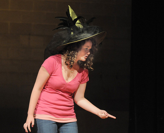 Tristine Henderson, the Wicked Witch of the West, scolds her minions during the Summer Youth Players tech rehearsal of The Wizard of Oz at Broomfield High School on Saturday.<br /> June 18, 2011<br /> staff photo/David R. Jennings