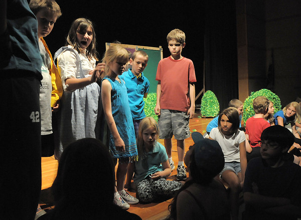 Summer Youth Players cast members listen to the co-directors during the tech rehearsal of The Wizard of Oz at Broomfield High School on Saturday. The cast of 50 is the largest in Summer Youth Players history.<br /> June 18, 2011<br /> staff photo/David R. Jennings