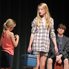 Megan Martin, 11, right, Dorothy, with Hadley Pancratz, 7, Toto, begin to leave home during the Summer Youth Players tech rehearsal of The Wizard of Oz at Broomfield High School on Saturday.<br /> June 18, 2011<br /> staff photo/David R. Jennings