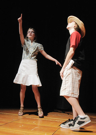 Grace Diamond, left, Auntie Em, points out the coming tornado to  Garrett Labuda, Uncle Henry, during the Summer Youth Players tech rehearsal of The Wizard of Oz at Broomfield High School on Saturday.<br /> June 18, 2011<br /> staff photo/David R. Jennings