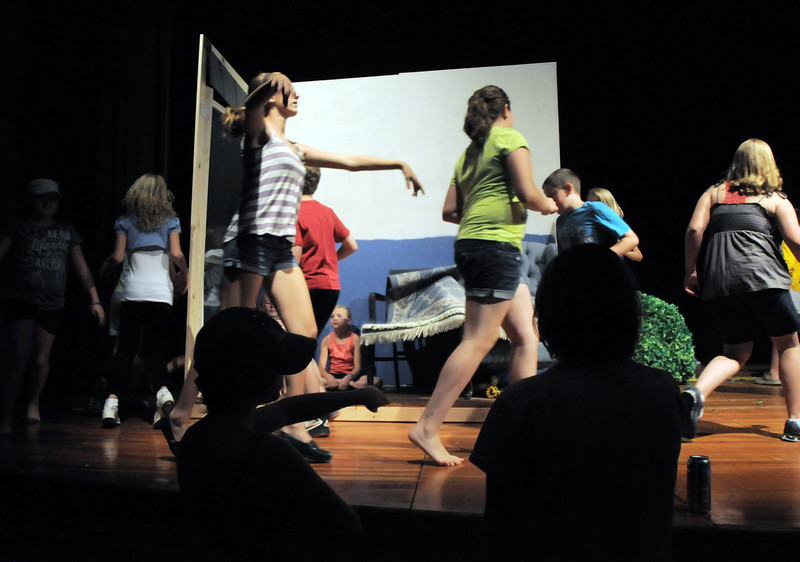 Dancers and Monkeys move around Dorothy's house to form the tornado during the Summer Youth Players tech rehearsal of The Wizard of Oz at Broomfield High School on Saturday.<br /> June 18, 2011<br /> staff photo/David R. Jennings