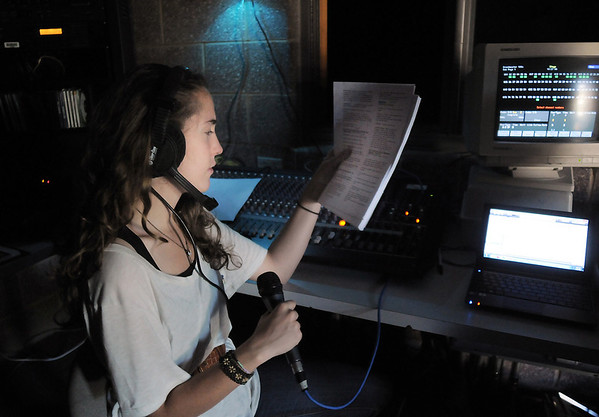 Rachel Kois works on lighting ques in the booth during the Summer Youth Players tech rehearsal of The Wizard of Oz at Broomfield High School on Saturday.<br /> June 18, 2011<br /> staff photo/David R. Jennings