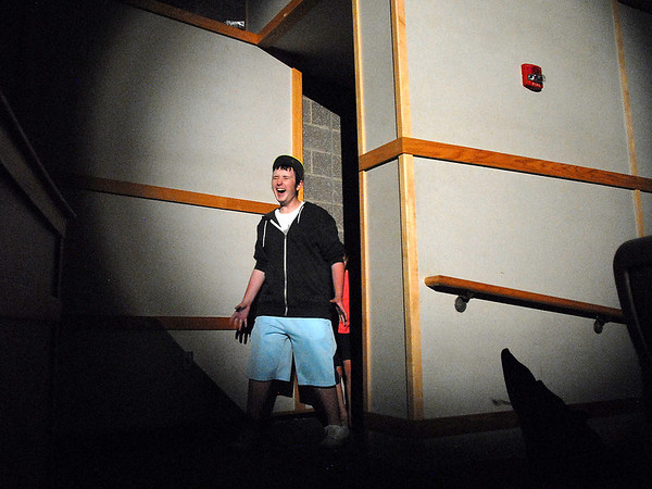 Beau Clayton, the Cowardly Lion,  screams as he come into the light while traveling to OZ during the Summer Youth Players tech rehearsal of The Wizard of Oz at Broomfield High School on Saturday.<br /> June 18, 2011<br /> staff photo/David R. Jennings