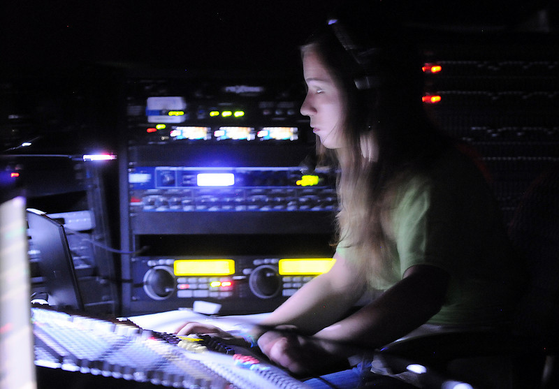 Assistant stage manager Maggie Admire works the sound board during Saturday's Summer Youth Players performance of The Princess and the Pea at the Audi.<br /> July 17, 2010<br /> Staff photo/ David R. Jennings