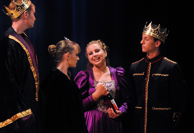 Bridget Admire second right, playing Queen Sophia greets  Hayden Schappel as prince Harcourt, right, and Beau Clayton, as prince Edgar and Lauren Nalezny as princess Greta during Saturday's Summer Youth Players performance of The Princess and the Pea at the Audi.<br /> July 17, 2010<br /> Staff photo/ David R. Jennings