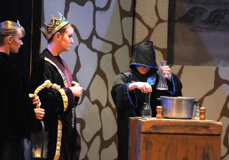 Princess Greta, Lauren Nalezny, left, and  prince Edgar, Beau Clayton, watch King Ulsed, played by Garrett Labuda, disguised as a monk make a magic potion during  Saturday's Summer Youth Players performance of The Princess and the Pea at the Audi.<br /> July 17, 2010<br /> Staff photo/ David R. Jennings