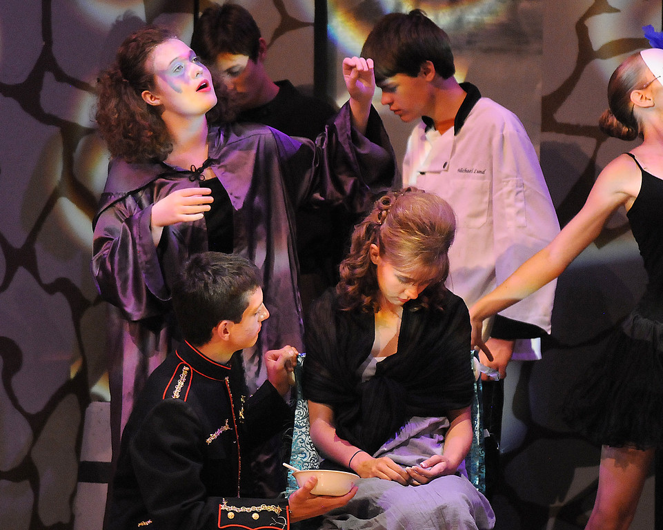Tristine Henderson portraying Isadora, top left,  freezes everyone except Hayden Schappel, bottom left,  portraying prince Harcourt, to give advice to the prince during Saturday's Summer Youth Players performance of The Princess and the Pea at the Audi.<br /> July 17, 2010<br /> Staff photo/ David R. Jennings