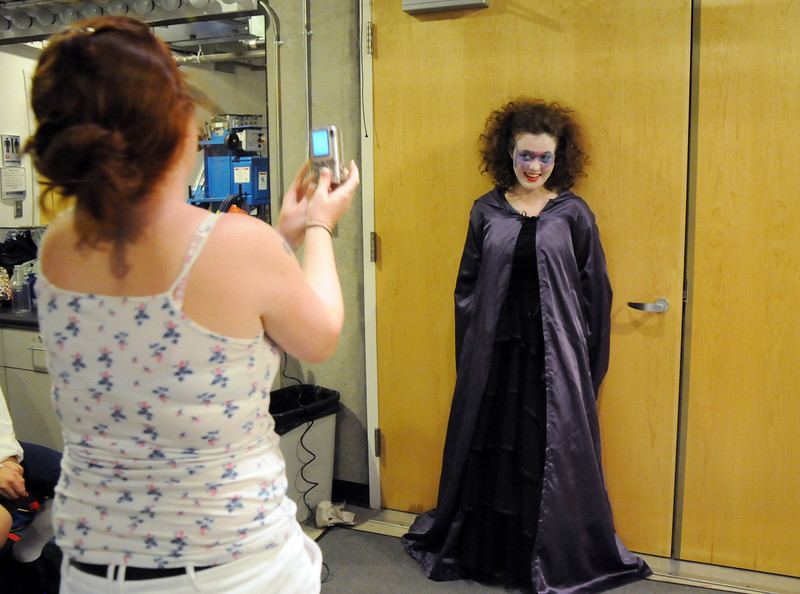 Make up artist Paula Nichols, left, takes a picture of Tristine Henderson  as a record of costumes and make-up before Saturday's Summer Youth Players performance of The Princess and the Pea at the Audi.<br /> July 17, 2010<br /> Staff photo/ David R. Jennings