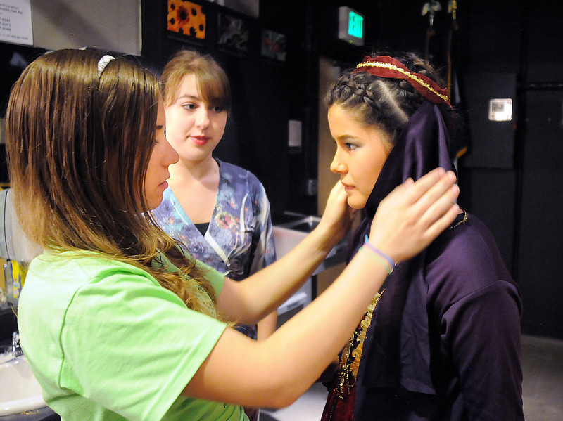 Maggie Admire, left, and director Hailey Barr make final adjustments to Camille Green's costume back stage before Saturday's Summer Youth Players performance of The Princess and the Pea at the Audi.<br /> July 17, 2010<br /> Staff photo/ David R. Jennings