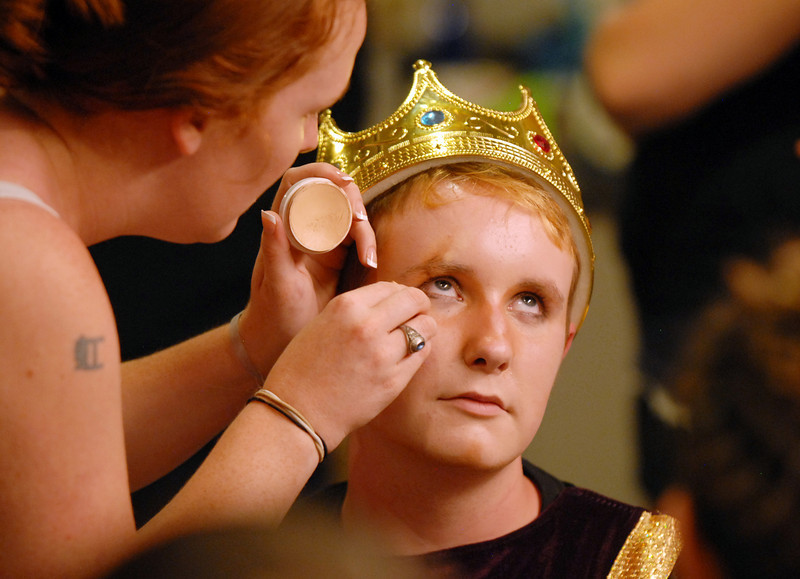 Make-up artist Paula Nichols works on Beau Clayton's scare for his portrayal of prince Edgar before  Saturday's Summer Youth Players performance of The Princess and the Pea at the Audi.<br /> July 17, 2010<br /> Staff photo/ David R. Jennings