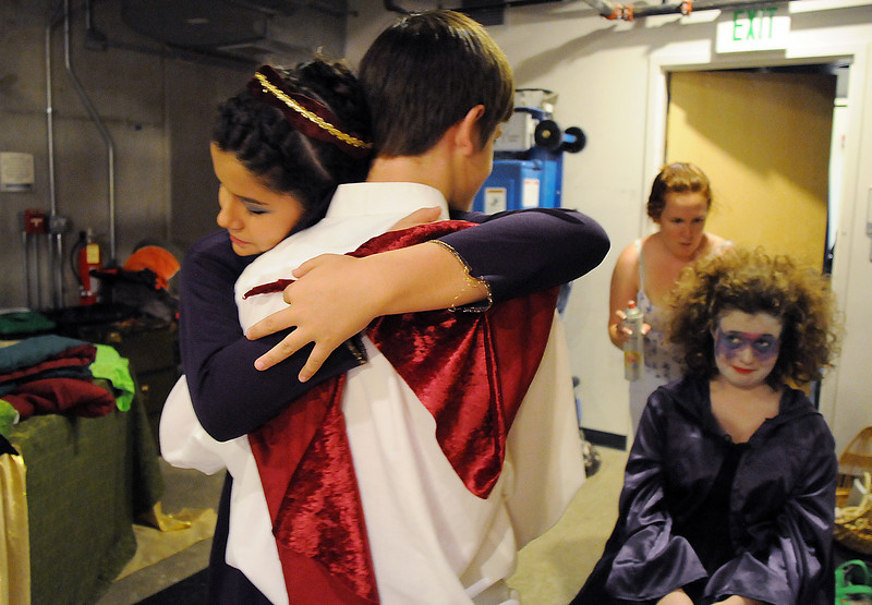 Camille Green, left, gives a pre-preformance hug to Jonathan Sterling while Tristine Henderson is in make-up with Paula Nichols before Saturday's Summer Youth Players performance of The Princess and the Pea at the Audi.<br /> July 17, 2010<br /> Staff photo/ David R. Jennings