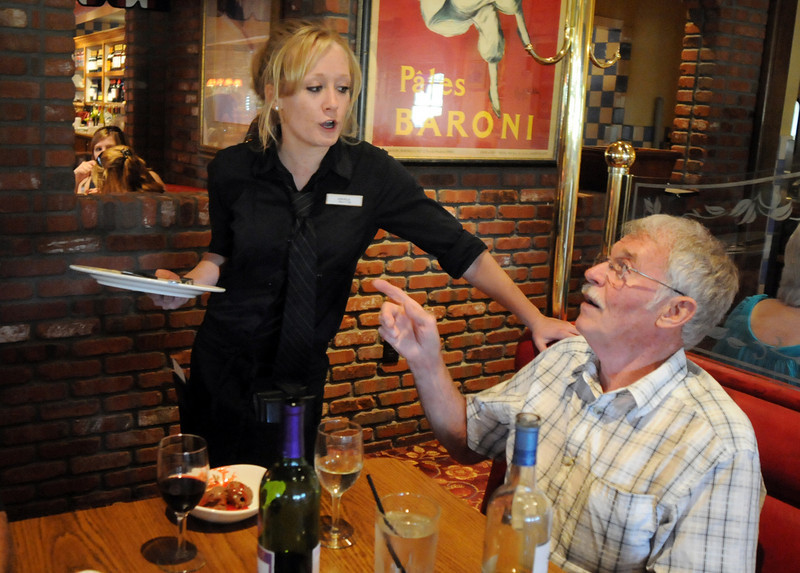 Waitress Angela French chats with Carl Sauerland during Summer Night at Mimi's benefit for Broomfield Senior Services at Mimi's Cafe on Wednesday.<br /> August 18, 2010<br /> staff photo/David R. Jennings