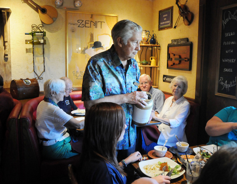 Leonard Muniz collects tips for the wait staff who donated their time for the Broomfield Senior Services benefit, Summer Night at Mimi's,  at Mimi's Cafe on Wednesday<br /> August 18, 2010<br /> staff photo/David R. Jennings