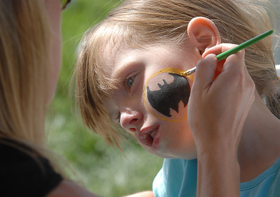 Samantha Labriola, 5, has a Batman symbol painting on to her cheek by Brooke Nordgren during Summer Sundays at the Brunner Farmhouse sponsored by the Broomfield Council on the Arts and Humanities on Sunday.  August 7, 2011 staff photo/ David R. Jennings
