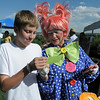 Bryce Wilcox, 14, left, reads a joke card with Thilly the clown, Cindy Card, during Summer Sundays at the Brunner Farmhouse sponsored by the Broomfield Council on the Arts and Humanities on Sunday.<br /> <br /> August 7, 2011<br /> staff photo/ David R. Jennings
