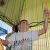 Conan Corcoran, 6, plucks the strings of Nancy Brace's harp duirng Summer Sundays at the Brunner Farmhouse sponsored by the Broomfield Council on the Arts and Humanities on Sunday.<br /> <br /> <br /> August 7, 2011<br /> staff photo/ David R. Jennings