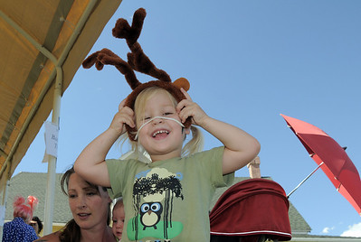 Tessa Corcoran, 3, tries on antlers at the Back Story Theater booth during Summer Sundays at the Brunner Farmhouse sponsored by the Broomfield Council on the Arts and Humanities on Sunday.  August 7, 2011 staff photo/ David R. Jennings