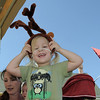Tessa Corcoran, 3, tries on antlers at the Back Story Theater booth during Summer Sundays at the Brunner Farmhouse sponsored by the Broomfield Council on the Arts and Humanities on Sunday.<br /> <br /> August 7, 2011<br /> staff photo/ David R. Jennings