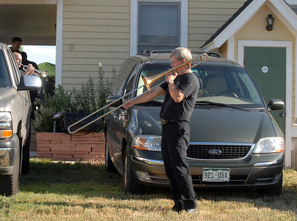 Ron Argotsinger warms up his trombone before playing with the Metropolitan Jazz Orchestra during Summer Sundays at the Brunner Farmhouse sponsored by the Broomfield Council on the Arts and Humanities on Sunday.<br /> <br /> August 7, 2011<br /> staff photo/ David R. Jennings