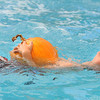 First grader Axel Bodeux carries a pumpkin while swimming during the 4th annual swimming with pumpkins classes taught by Liz Kaplan at Broomfield Academy on Wednesday.<br /> October 19, 2011<br /> staff photo/ David R. Jennings