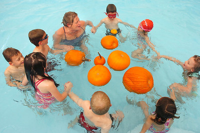 The first grade class swims around pumpkins lead by Liz Kaplan during the 4th annual swimming with pumpkins at Broomfield Academy on Wednesday. October 19, 2011 staff photo/ David R. Jennings