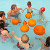 The first grade class swims around pumpkins lead by Liz Kaplan during the 4th annual swimming with pumpkins at Broomfield Academy on Wednesday.<br /> October 19, 2011<br /> staff photo/ David R. Jennings