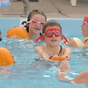 First graders Axel Bodeux, center, Brady Bowman, left, with Cadence Ames and Giovana Giorgetti during the 4th annual swimming with pumpkins classes taught by Liz Kaplan at Broomfield Academy on Wednesday.<br /> October 19, 2011<br /> staff photo/ David R. Jennings