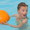 First grader Juliana Perez swims around the pool with her pumpkin during the 4th annual swimming with pumpkins classes taught by Liz Kaplan at Broomfield Academy on Wednesday.<br /> <br /> October 19, 2011<br /> staff photo/ David R. Jennings