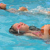 First graders Cadence Ames and Giovana Giorgetti carry pumpkins while swimming during the 4th annual swimming with pumpkins classes taught by Liz Kaplan at Broomfield Academy on Wednesday.<br /> <br /> October 19, 2011<br /> staff photo/ David R. Jennings