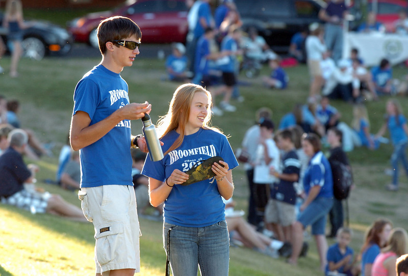 BE0919tail09<br /> Eric Steele and Madison Goering watch football fans at the tailgate party before Saturday's cross town game at Elizabeth Kennedy Stadium..<br /> <br /> September 11, 2010<br /> staff photo/David R. Jennings