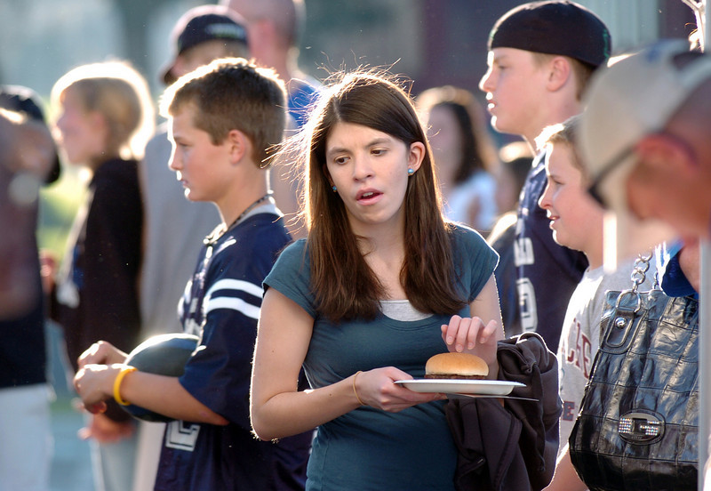 BE0919tail08<br /> Fans stand in line for food at the tailgate party before Saturday's cross town game at Elizabeth Kennedy Stadium..<br /> <br /> September 11, 2010<br /> staff photo/David R. Jennings
