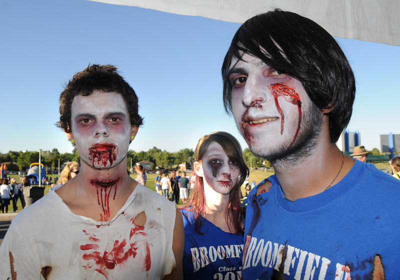 BE0919tail02<br /> Macus Nunez, 16, left, Lisa Kingsbury, 17, and Victor Rios, 17, wore zombie makeup to the tailgate party before Saturday's cross town game at Elizabeth Kennedy Stadium..<br /> <br /> September 11, 2010<br /> staff photo/David R. Jennings