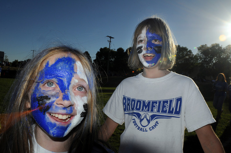 BE0919tail01<br /> Melanie Long, 9, left, and Jenna Burgesser, 9,  painted their face for the tailgate party before Saturday's cross town game at Elizabeth Kennedy Stadium..<br /> <br /> September 11, 2010<br /> staff photo/David R. Jennings