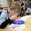 Griffin Waters, 7, adds an acid solution to milk in a petri dish at the Mad Scientist station during take our Daughters and Sons to Work Day at White Wave Foods on Thursday.<br /> April 28, 2011<br /> staff photo/David R. Jennings