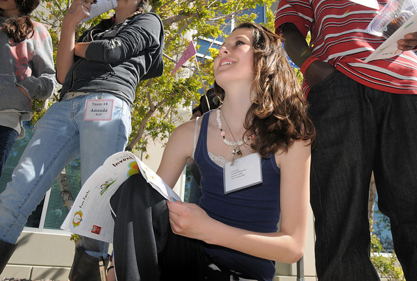 Amilia Rolf, 13, takes notes at the Denver Zoo's The Power of Poop station which demonstrates how waste materials can be converted to poser during take our Daughters and Sons to Work Day at White Wave Foods on Thursday.<br /> April 28, 2011<br /> staff photo/David R. Jennings